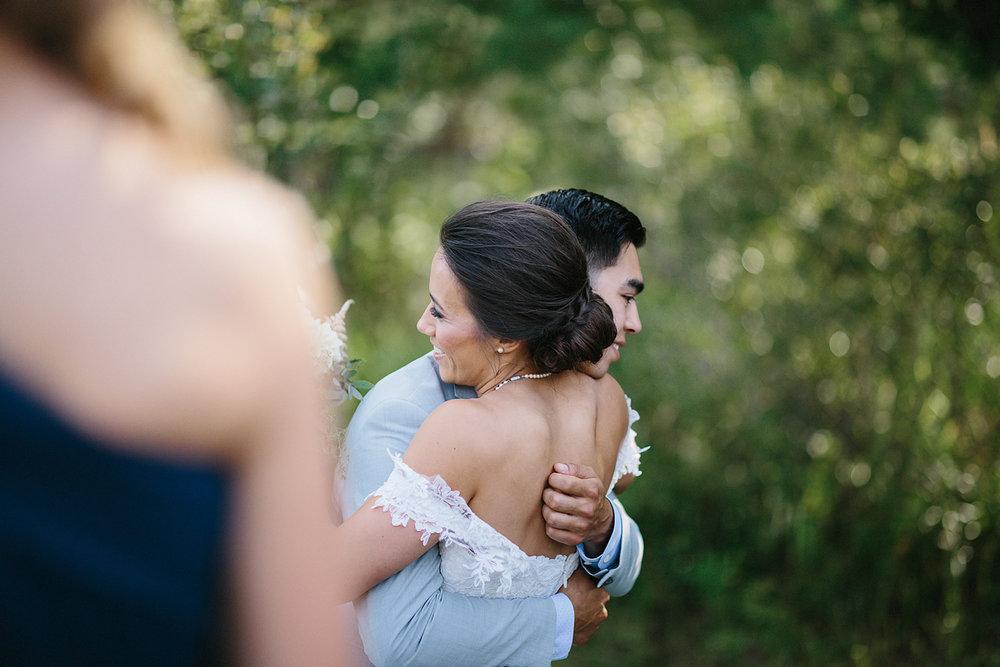 muskoka-wedding-photographer-hidden-valley-resort-film-photography-junebug-weddings-inspiration-wedding-decoration-ideas-cocktail-hour-bride-hugging-brother.jpg