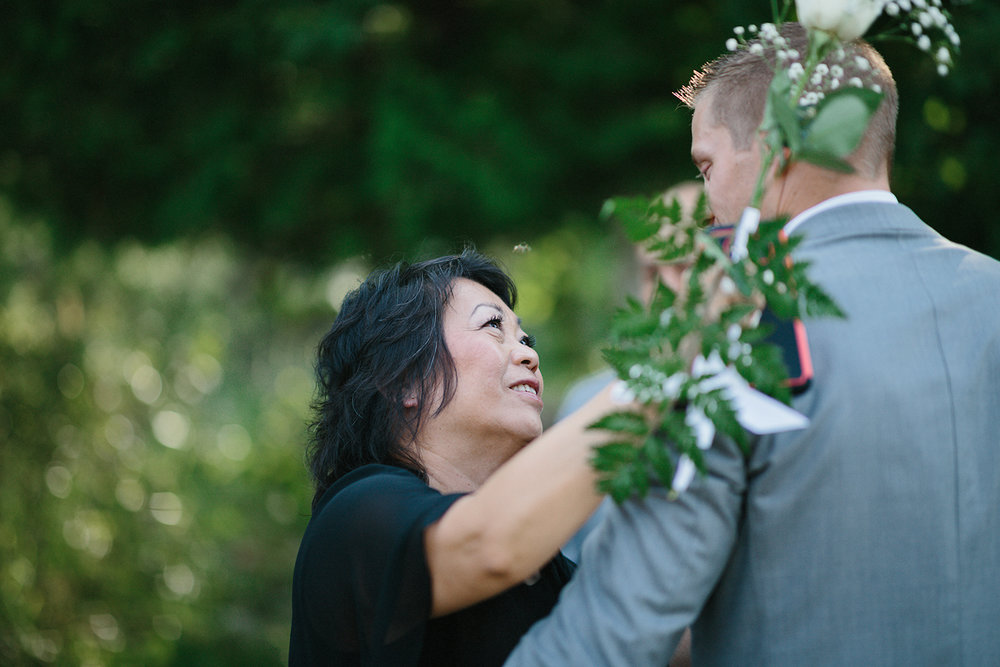 Graydon-Hall-Manor-Wedding-Toronto's-Best-Wedding-Photography-Ryanne-Hollies-Intimate-Small-Modern-Colourful-Wedding-First-Look-on-the-grounds-bride-and-groom-best-reaction-candid-documentary-holding-dress.jpg