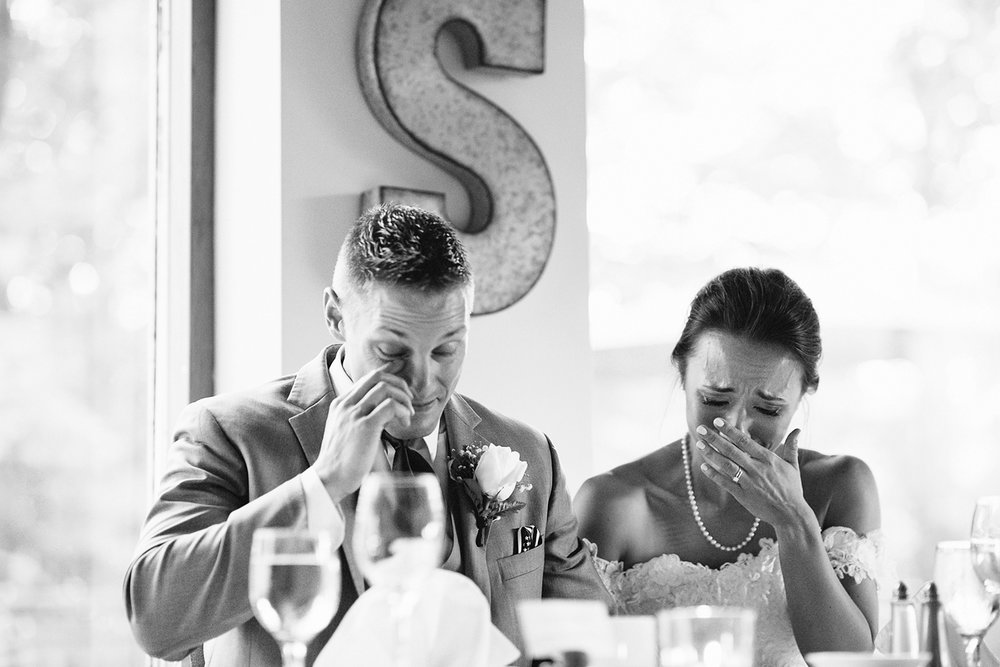 muskoka-wedding-photographer-hidden-valley-resort-film-photography-junebug-weddings-inspiration-bride-and-groom-couples-portraits-best-toronto-wedding-photographers-reception-decorations-video-surprise-both-crying-and-emotional-bw.jpg