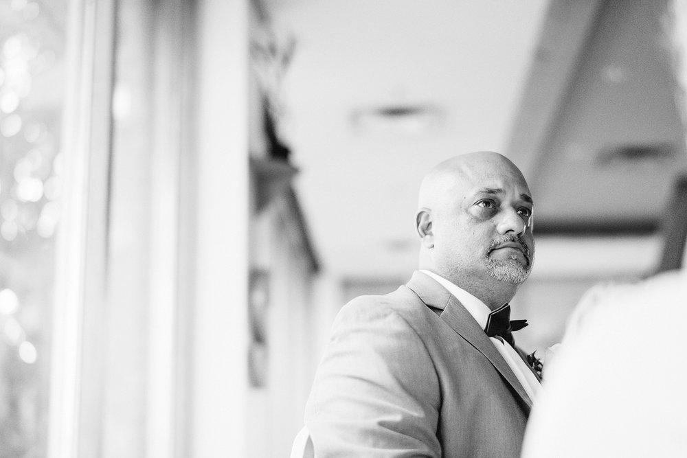 muskoka-wedding-photographer-hidden-valley-resort-film-photography-junebug-weddings-inspiration-wedding-decoration-ideas-reception-bride-and-groom-speech-guests-emotional.jpg