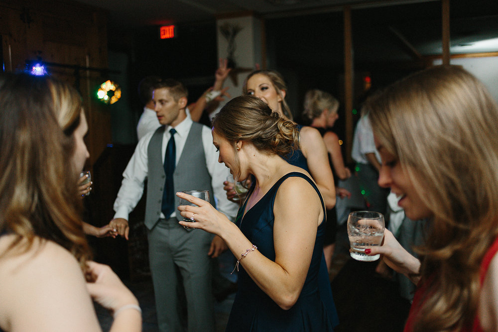 hidden-valley-resort-film-photography-torontos-best-wedding-photographers-ryanne-hollies-photography-calgary-muskoka-haliburton-port-carling-cottage-wedding-at-resort-party-candid-documentary-photography-brides-best-friend-partying.jpg