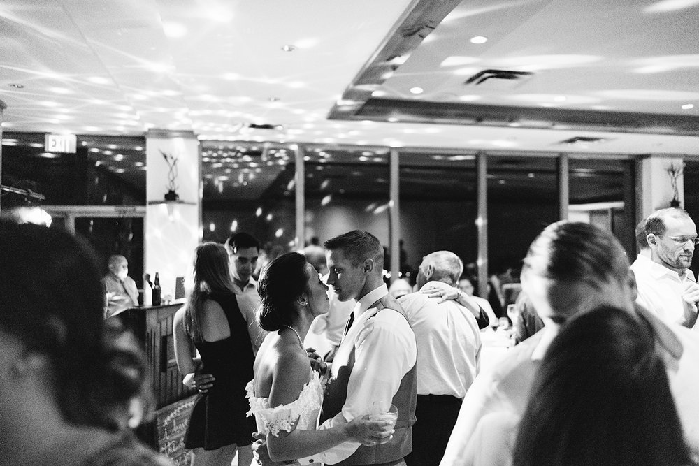 _torontos-best-wedding-photographers-ryanne-hollies-photography-calgary-muskoka-haliburton-port-carling-cottage-wedding-at-resort-party-candid-documentary-photography-guests-dancing-in-disco-lights-bride-and-groom-slow-dancing.jpg