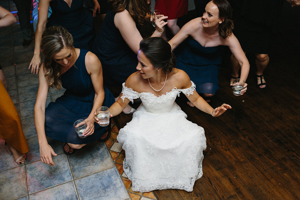 hidden-valley-resort-film-photography-torontos-best-wedding-photographers-ryanne-hollies-photography-calgary-muskoka-haliburton-port-carling-cottage-wedding-at-resort-party-candid-documentary-photography-bride-and-friends-dancing.jpg