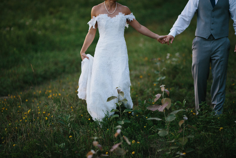 hidden-valley-resort-film-photography-west-coast-pacific-north-west-vancouver-bc-inspired-torontos-best-wedding-photographer-ryanne-hollies-photography-portraits-of-gorgeous-vintage-bride-and-groom-epic-walking-and-holding-hands.jpg