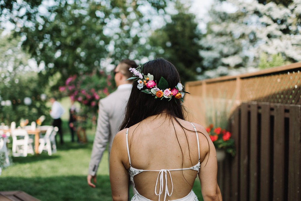 Backyard-family-intimate-cottage-wedding-chatum-kent-toronto-ontario-film-photographer-ryanne-hollies-photography-diy-string-lights-and-lanterns-reception-dinner-candid-entering.jpg