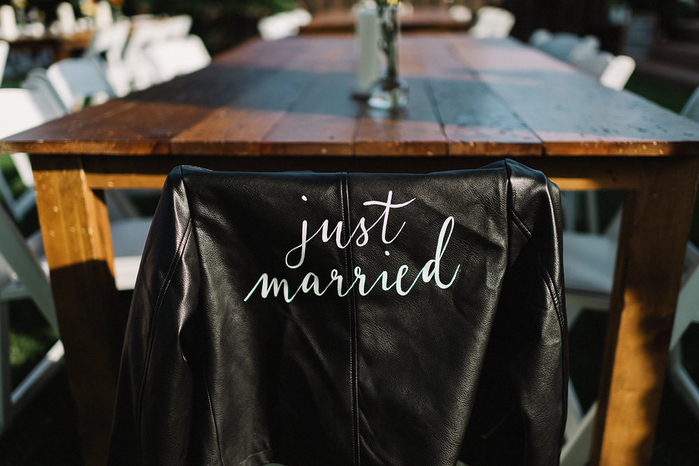 Backyard-family-intimate-cottage-wedding-chatum-kent-toronto-ontario-film-photographer-ryanne-hollies-photography-diy-string-lights-and-lanterns-reception-dinner-documentary-graphic-designer-diy-just-married-leather-jacket.jpg
