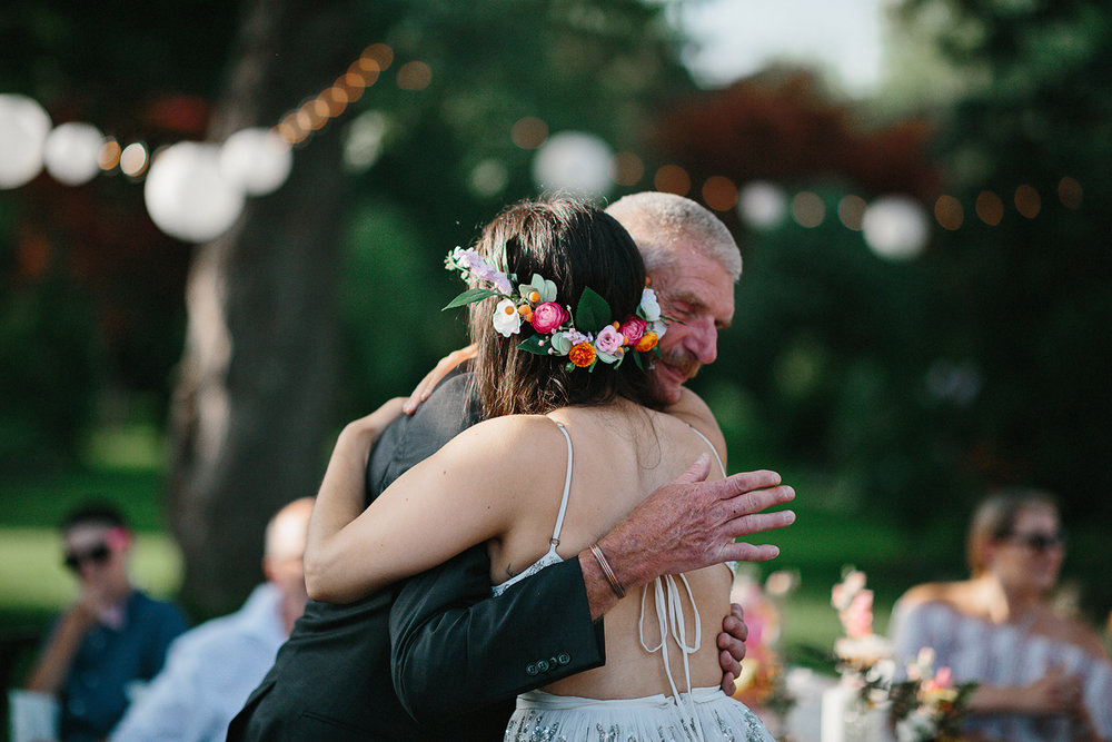 Backyard-family-wedding-chatum-kent-toronto-film-photographer-ryanne-hollies-photography-diy-string-lights-and-lanterns-reception-dinner-documentary-wooden-harvest-tables-diy-decor-speeches-bride-and-groom-hugging-dad.jpg