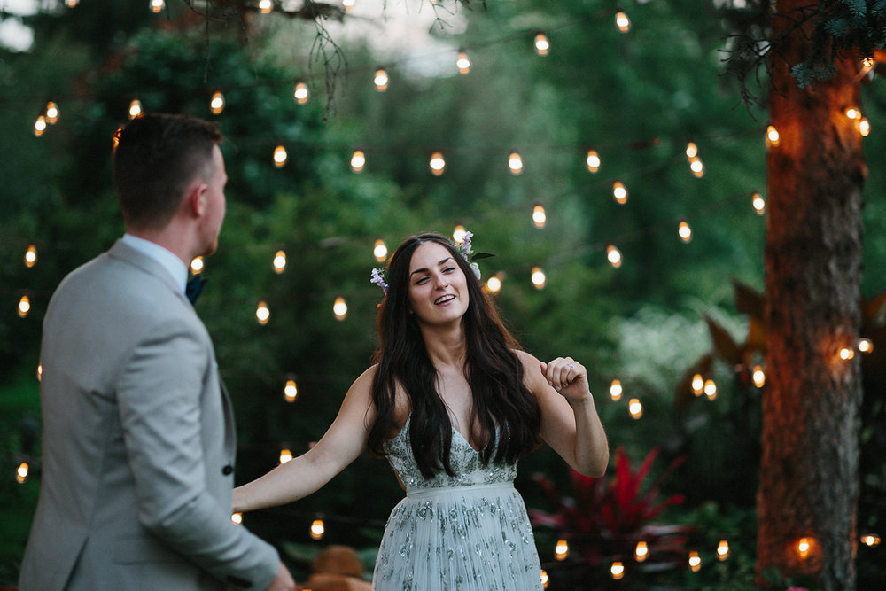 Backyard-toronto-film-photographer-ryanne-hollies-photography-diy-string-lights-and-lanterns-reception-first-dance-documentary-fun-candid-dancing-bride.jpg