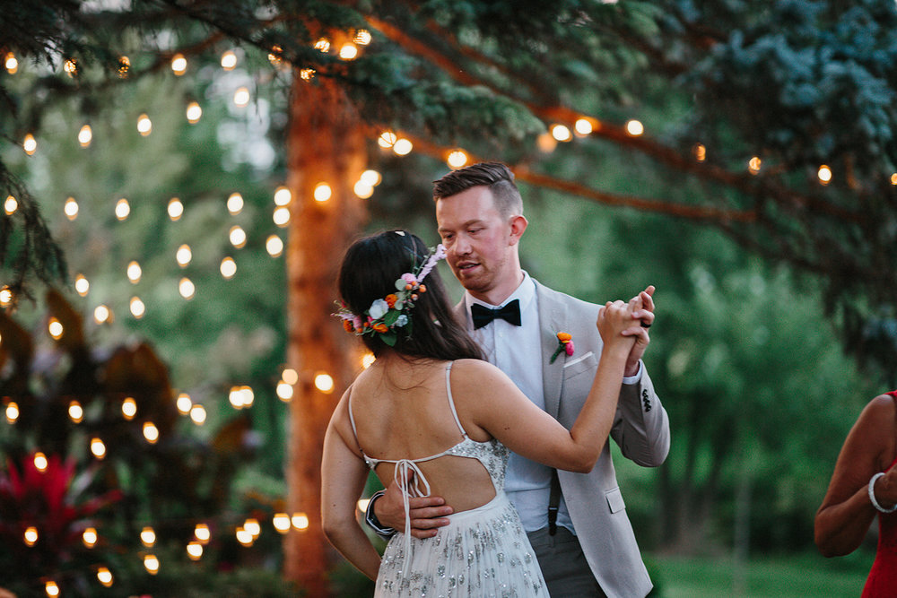 Backyard-toronto-film-photographer-ryanne-hollies-photography-diy-string-lights-and-lanterns-reception-first-dance-documentary-fun-candid-dancing-together-bride-and-groom.jpg