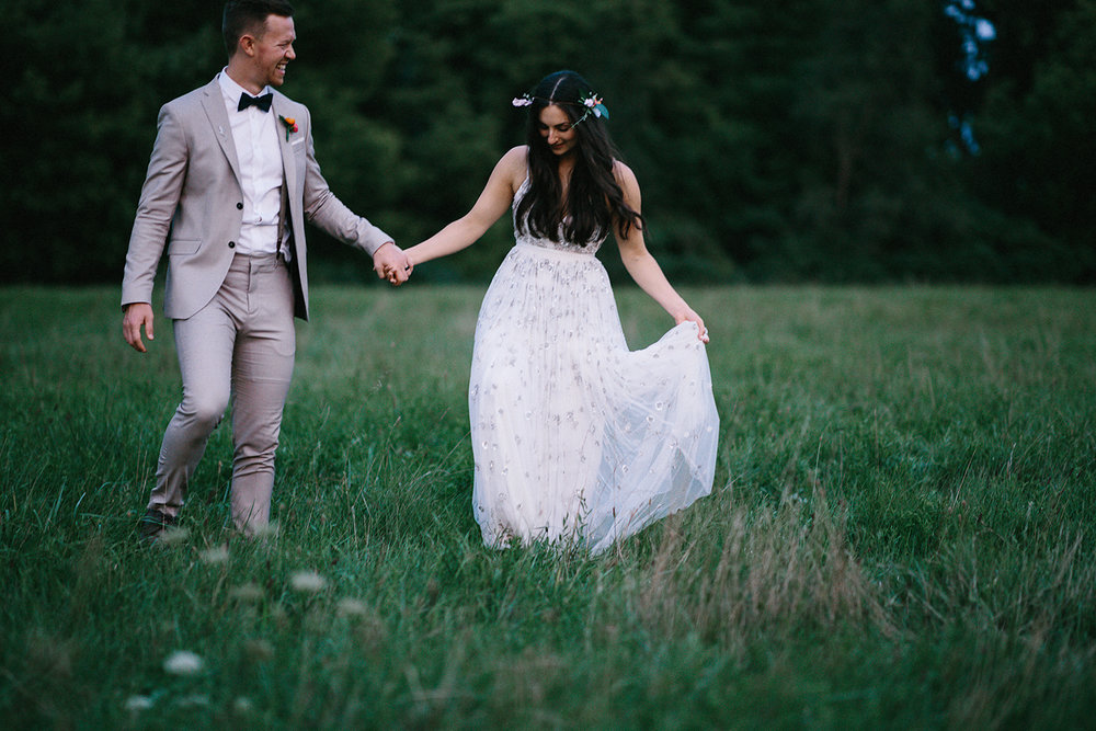 Backyard-toronto-film-photographer-ryanne-hollies-photography-analog-photography-torontos-best-wedding-photographers-night-portraits-bride-and-groom-candid-intimate-moody-dark-romantic-field-of-flowers-walking.jpg