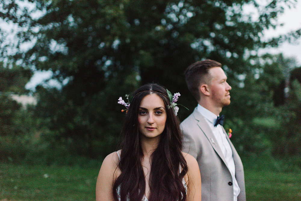 Backyard-toronto-film-photographer-ryanne-hollies-photography-analog-photography-torontos-best-wedding-photographers-night-portraits-bride-and-groom-candid-intimate-moody-dark-romantic-under-tree-trendy-alternative-artistic-grain.jpg