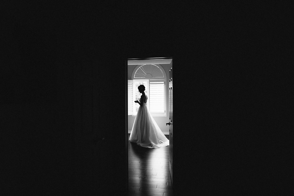 Best-Toronto-Wedding-Photographers-Photojournalistic-Wedding-Photography-in-Toronto-Ryanne-Hollies-Photography-candid-documentary-bradford-newmarket-bride-getting-ready-lea-ann-belter-bridal-portrait-moody-romantic-vintage-dress-silhouette.jpg