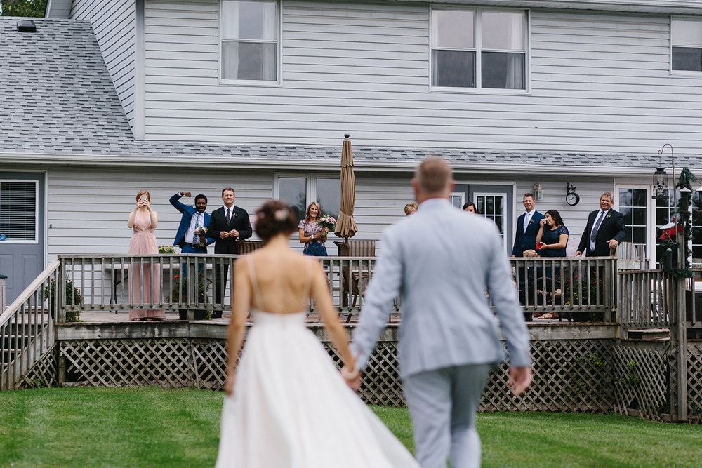 11-cambium-farms-wedding-toronto-wedding-photographer-ryanne-hollies-photography-gay-wedding-farm-wedding-inspiriration-candid-documetary-tattooed-bride-portrait-first-look-brides-candid-moments-brides-portrait-intimate-under-tree-fun.jpg