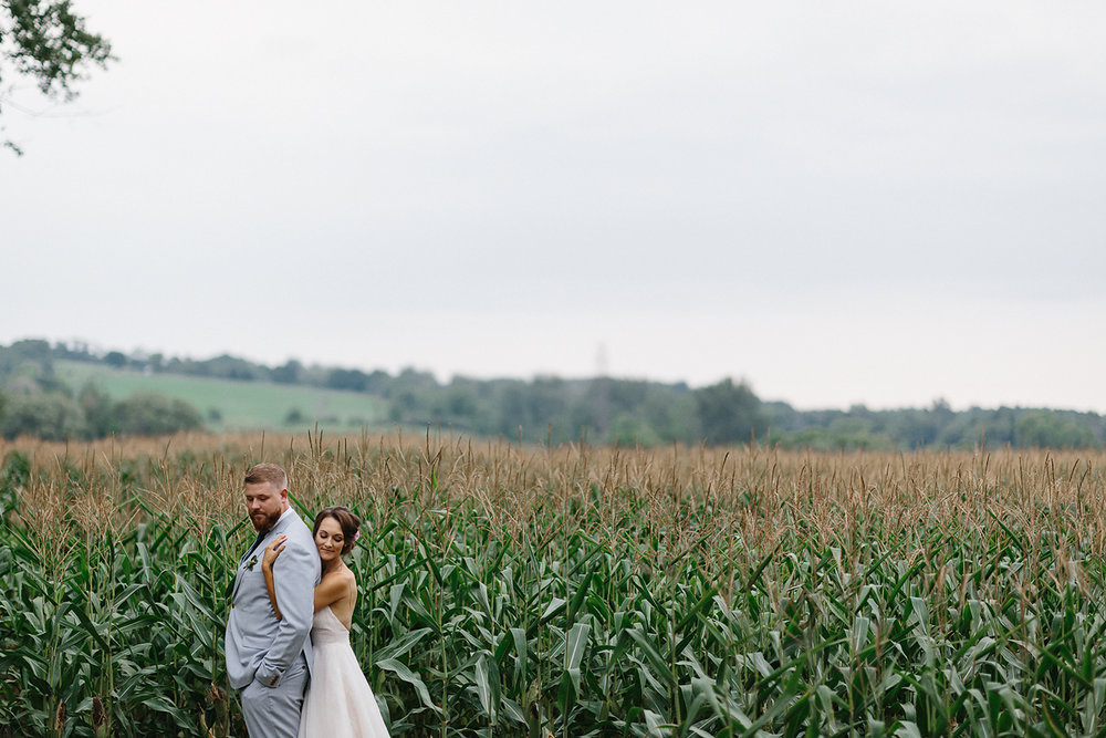 Best-Toronto-Wedding-Photographers-Photojournalistic-Wedding-Photography-in-Toronto-Ryanne-Hollies-Photography-candid-documentary-bradford-family-farm-rustic-venue-inspiration-bride-and-groom-portraits-in-corn-field-cinematic.jpg