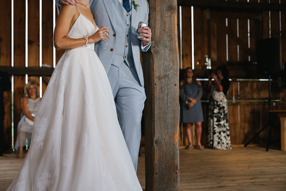 cambium-farms-wedding-ryanne-hollies-photography-gay-wedding-lgbtq-trendy-cool-badass-junebug-weddings-inspiration-wedding-reception-in-a-barn-speeches-bride-and-bride-with-father-laughing-emotional.jpg