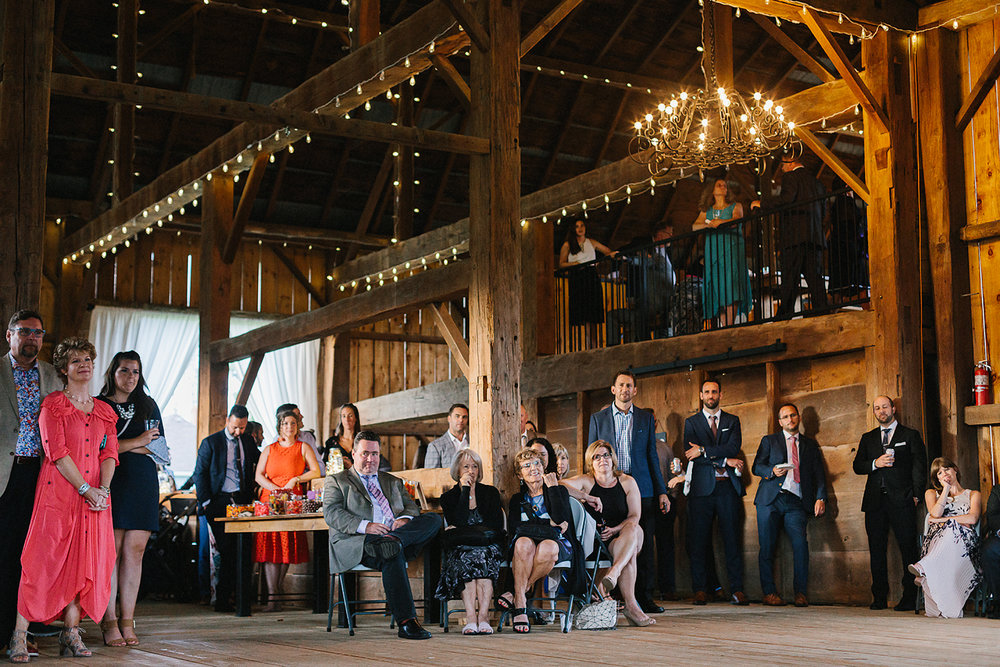 41-ryanne-hollies-photography-gay-wedding-lgbtq-trendy-cool-badass-junebug-weddings-inspiration-reception-celebration-barn-lit-by-string-lights-photojournalistic-speeches-brides-laughing-embarrassed-friends-singing-musical-song-from-popula.jpg