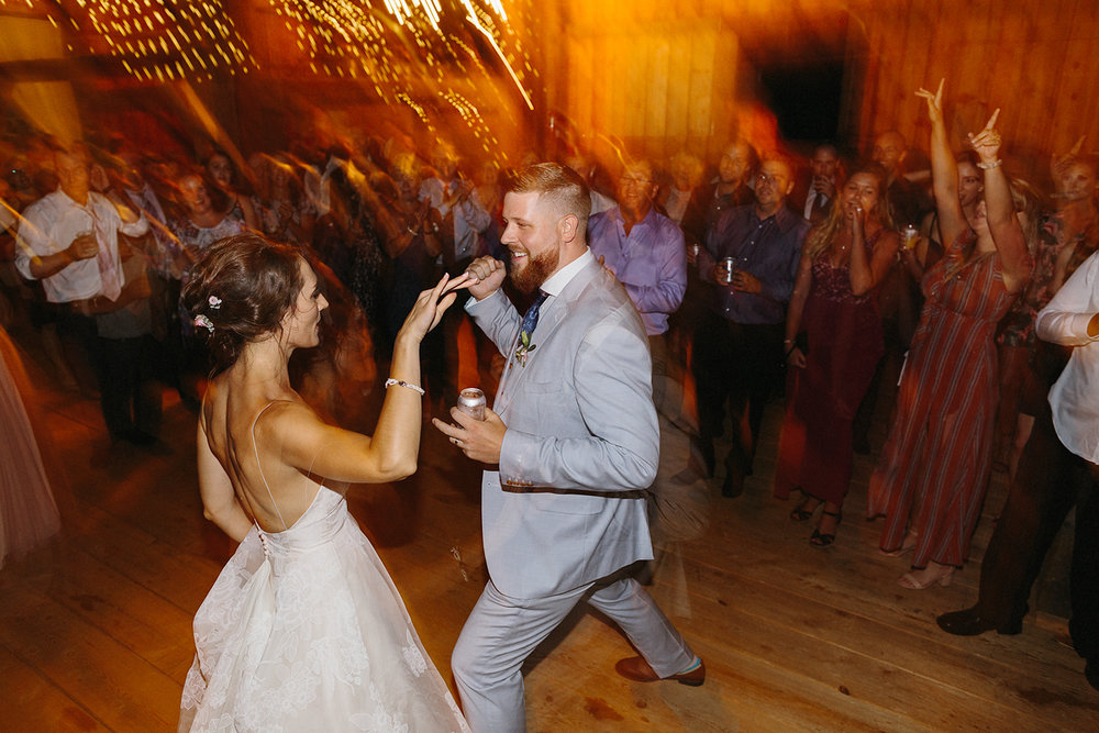 Candid-Toronto-Wedding-Photographers-Photojournalistic-Wedding-Photography-in-Toronto-Ryanne-Hollies-bradford-barn-best-dancing-photos-string-lights-party-time-guests-partying-hard-bride-and-groom-dancing.jpg