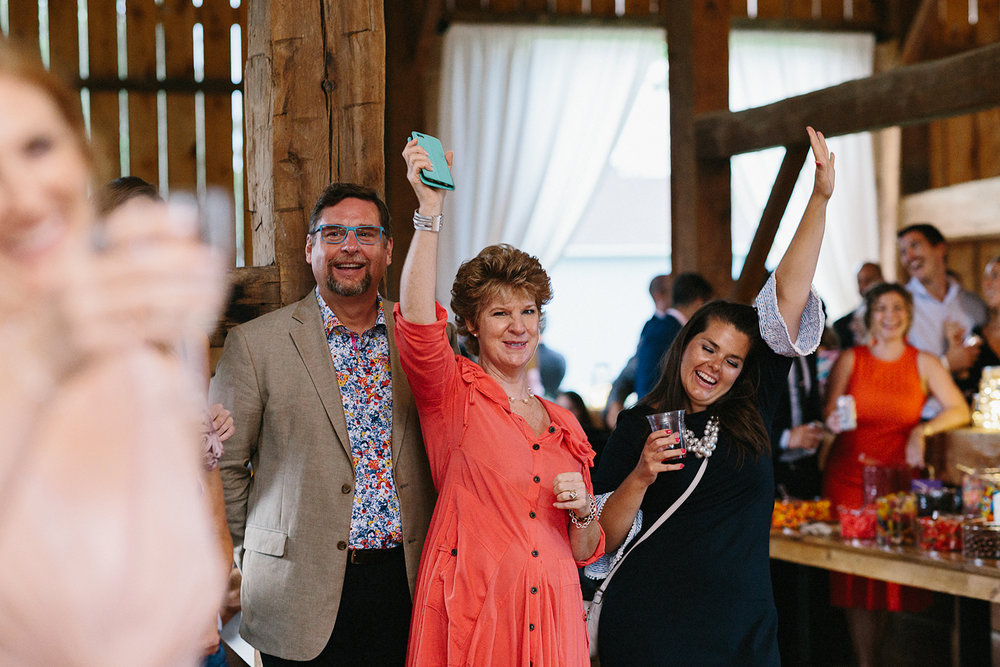 Editorial-Toronto-Wedding-Photographers-Photojournalistic-Wedding-Photography-in-Toronto-Ryanne-Hollies-Photography-vintage-barn-wedding-inspiration-reception-speeches-guests-cheering.jpg