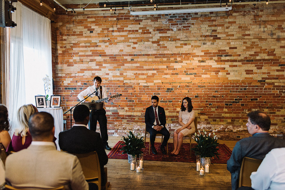 Best-Toronto-Wedding-Photographers-Afforadable-Candid-Photojournalistic-Photography-Toronto-Gladstone-Hotel-Wedding-Venue-Downtown-Urban-Brunch-Wedding-Inspiration-persian-ceremony-friend-playing-guitar.jpg