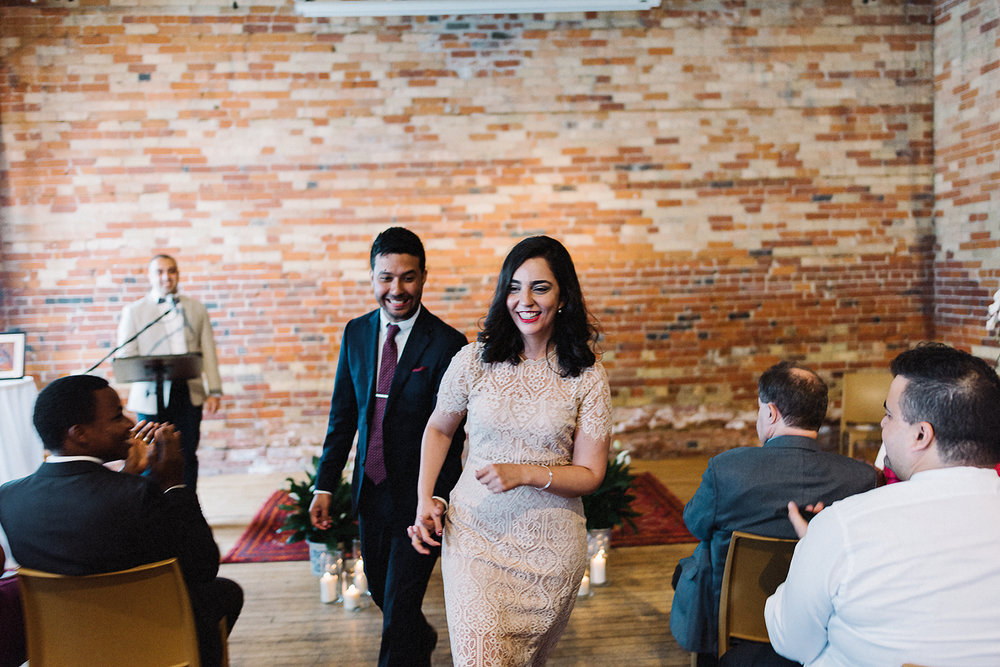 Best-Toronto-Wedding-Photographers-Afforadable-Candid-Photojournalistic-Photography-Toronto-Gladstone-Hotel-Wedding-Venue-Downtown-Urban-Brunch-Wedding-Inspiration-persian-ceremony-bride-and-groom-exit.jpg