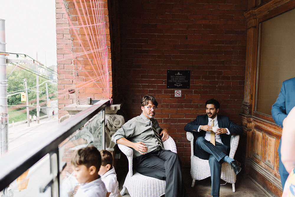 Best-Toronto-Wedding-Photographers-Afforadable-Candid-Photojournalistic-Photography-Toronto-Gladstone-Hotel-Wedding-Venue-Downtown-Urban-Brunch-Wedding-Inspiration-persian-ceremony-guests-Mingling-on-balcony.jpg
