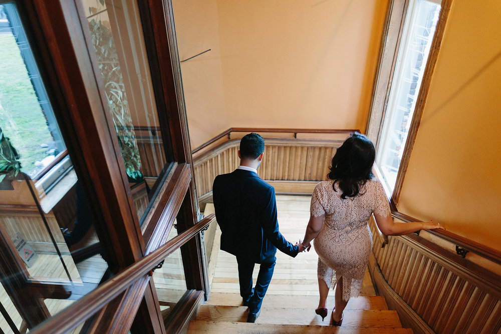 Best-Wedding-Photographers-in-Toronto-Downtown-Urban-Gladstone-Hotel-Venue-Inspiration-Top-Venues-in-Toronto-boutique-hotel-candid-documentary-bride-and-groom-portraits-stairs-romantic-moody-editorial-magazine-walking-down.jpg