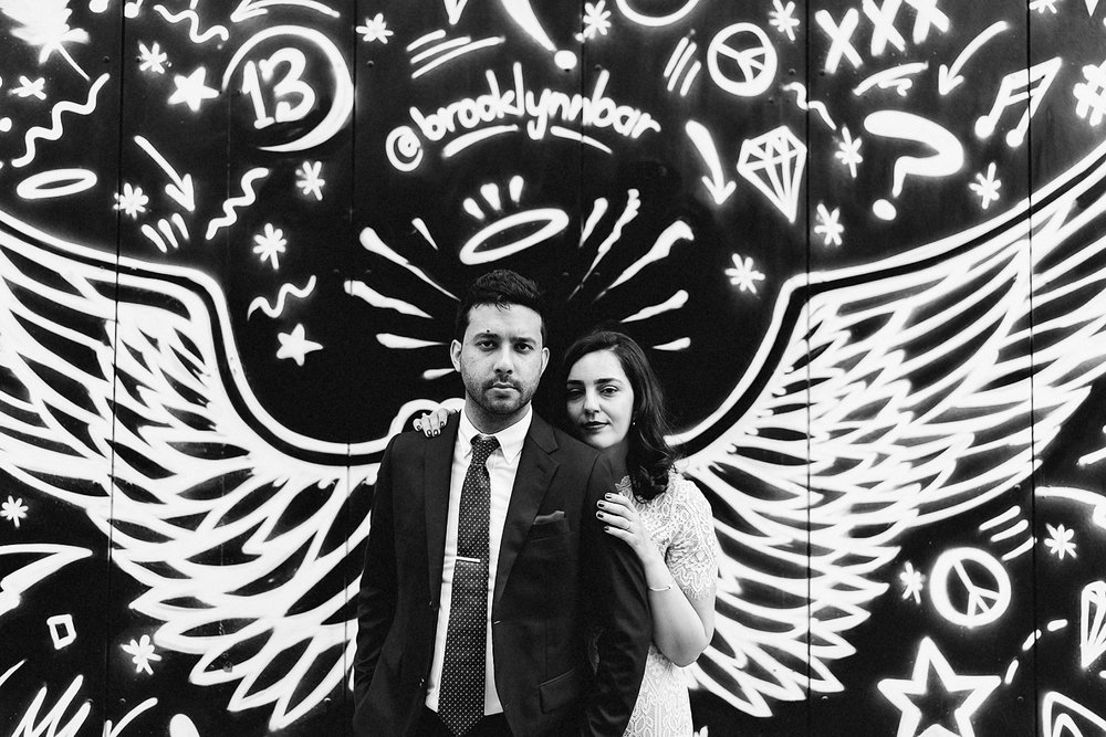 Bride-and-Groom-Portraits-at-Major-Treat-Coffee-Shop-Gladstone-Hotel-Wedding-Candid-Portraits-of-Groom-and-bride-with-angel-wing-graffiti.jpg
