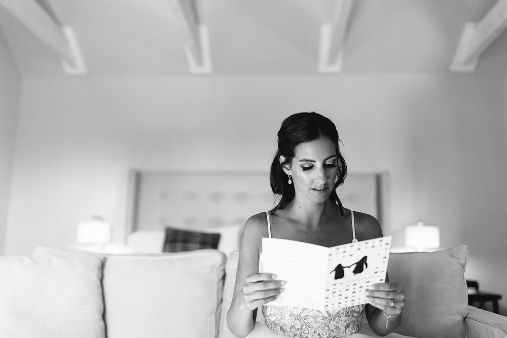 Bride-reading-letter-from-groom-At-Egaridge-Resort-Venue-Muskoka-Ontario.jpg