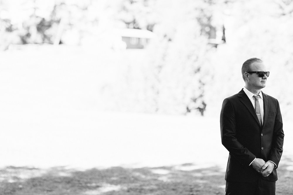 Groom-waiting-for-bride-for-first-look-At-Egaridge-Resort-Venue-Muskoka-Ontario.jpg