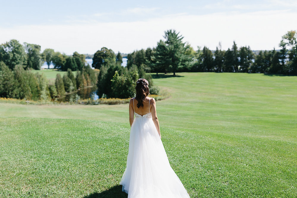 Bride-walking-up-togroom-from-far-away-At-Egaridge-Resort-Venue-Muskoka-Ontario.jpg