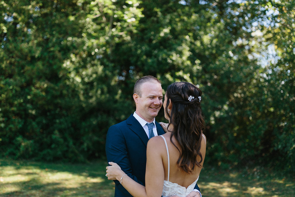 Couples-Portraits-groom-laughing-At-Egaridge-Resort-Venue-Muskoka-Ontario-Wedding-Photography-by-Ryanne-Hollies-Photography-Toronto-Documentary-Wedding-Photographer.jpg