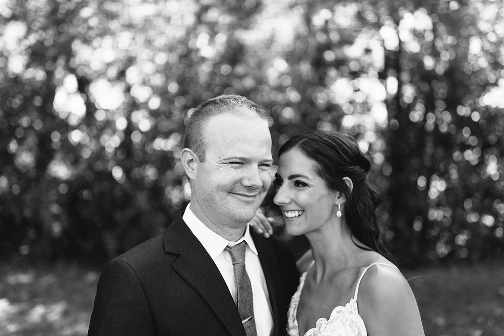 Couples-Portraits-groom-laughing-cute-At-Egaridge-Resort-Venue-Muskoka-Ontario-Wedding-Photography-by-Ryanne-Hollies-Photography-Toronto-Documentary-Wedding-Photographer.jpg