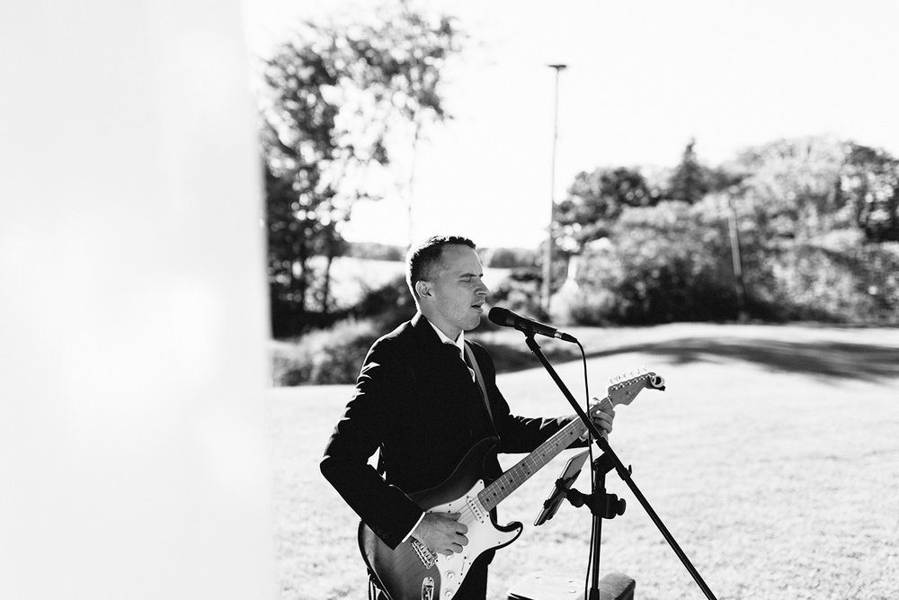 ceremony-signing-musician-singing-At-Eganridge-Resort-Venue-Muskoka-Ontario-Wedding-Photography-by-Ryanne-Hollies-Photography-Toronto-Documentary-Wedding-Photographer.jpg