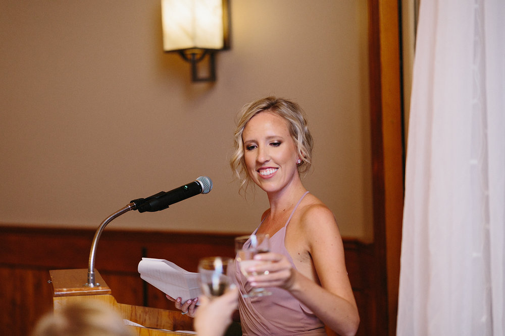 bridesmaid-speech-cheers-toast-during-reception-At-Eganridge-Resort-Venue-Muskoka-Ontario-Wedding-Photography-by-Ryanne-Hollies-Photography-Toronto-Documentary-Wedding-Photographer.jpg