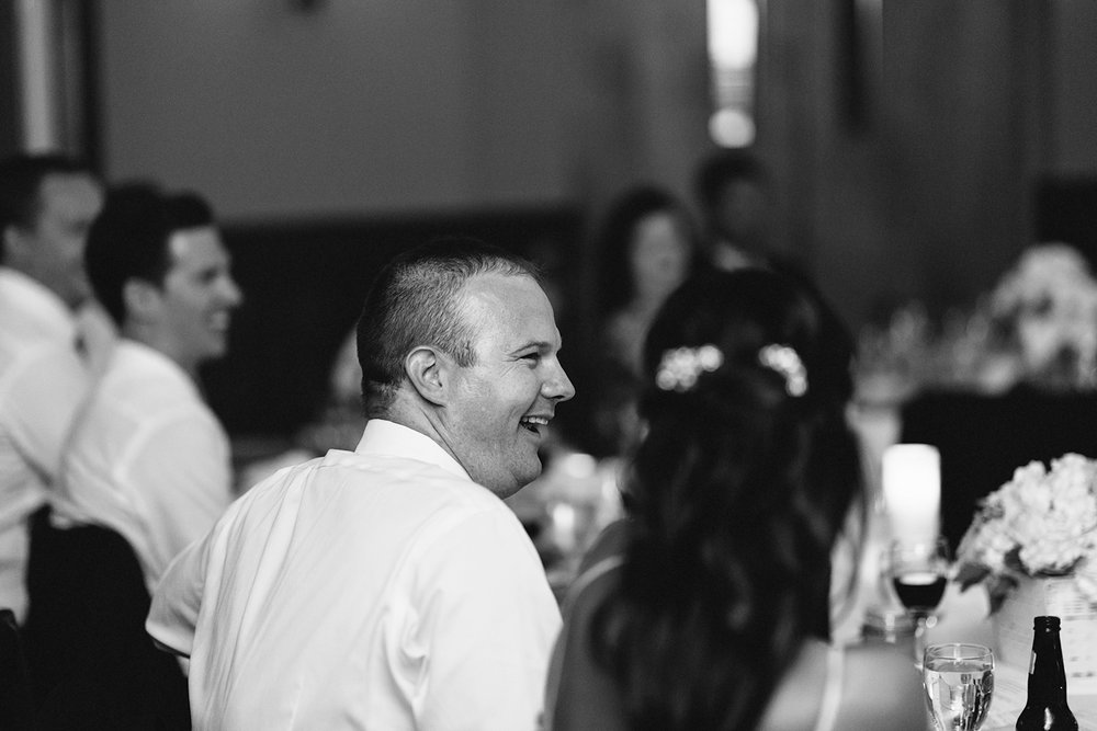 groom-laughing-at-speech-during-reception-At-Eganridge-Resort-Venue-Muskoka-Ontario-Wedding-Photography-by-Ryanne-Hollies-Photography-Toronto-Documentary-Wedding-Photographer.jpg