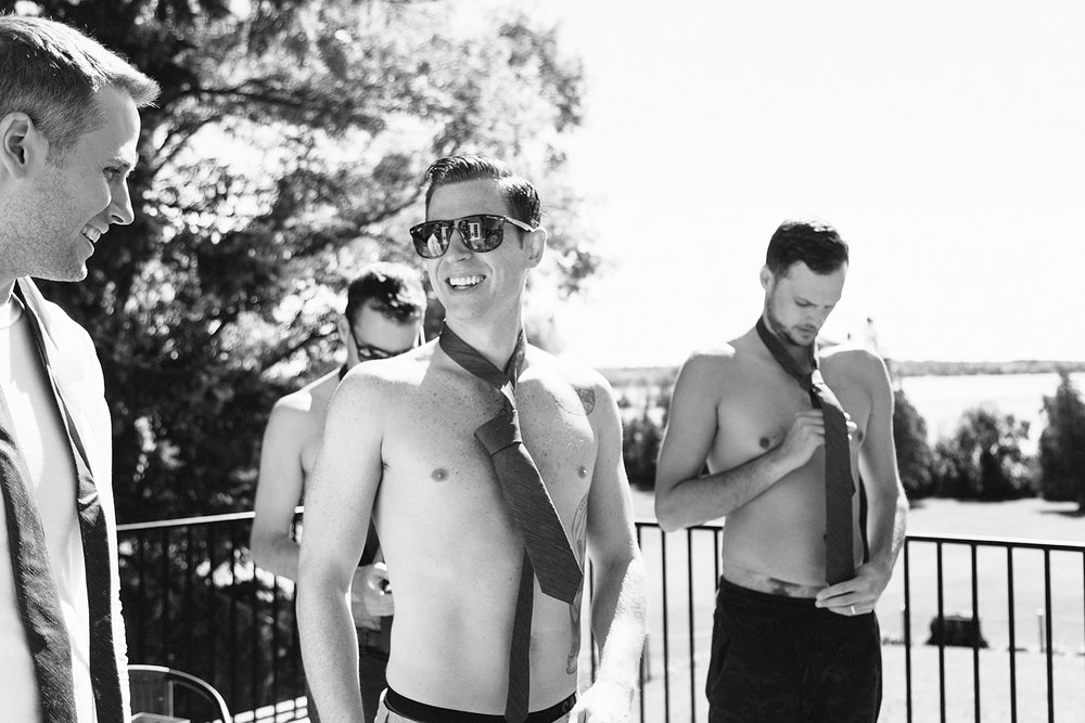 Groomsmen-in-ties-with-no-shirts-At-Egaridge-Resort-Venue-Muskoka-Ontario.jpg