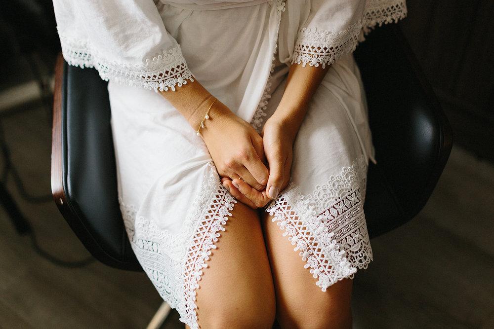 detail-of-brides-hands-wearing-white-bridal-robe-london-ontario-wedding-inspiration.jpg