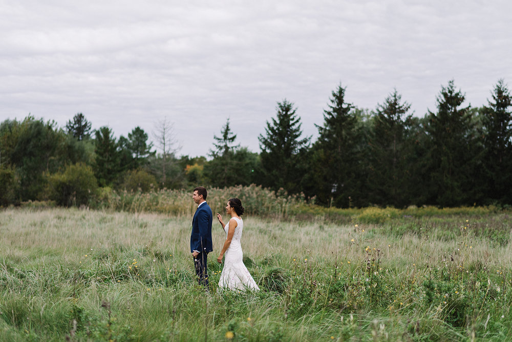 bellamere-winery-cottage-first-look-bride-walking-up-cinetmatic-romantic-best-torontos-wedding-photographers-candid-documentary-style-photography-london-ontario-winery-wedding-inspiration.jpg