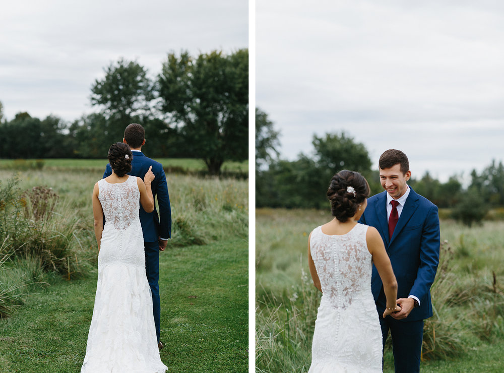 18-bellamere-london-venue-first-look-bride-and-groom-hugging-in-field-cinetmatic-best-torontos-wedding-photographers-candid-documentary-style-photography-london-ontario-winery-wedding-inspiration.jpg