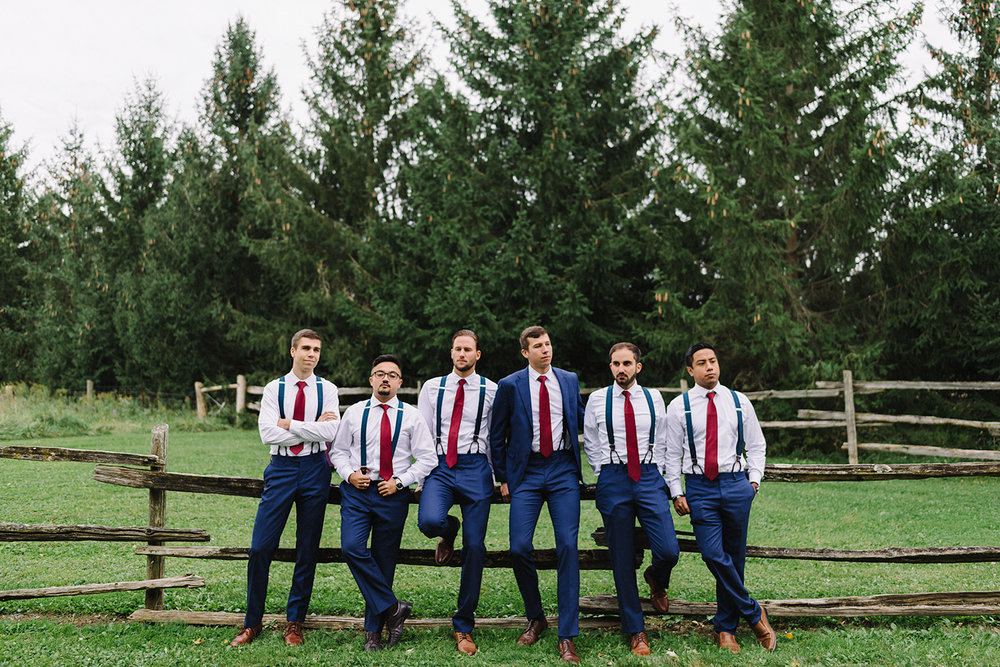 bridal-party-groomsmen-badass-candid-fun-real-moments-at-bellamere-winery-toronto's-best-wedding-photographers-candid-documentary-style-photography-london-ontario-winery-wedding-inspiration.jpg