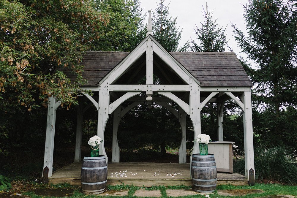 bellamere-winery-ceremony-under-pergola-in-field-rustic-toronto's-best-wedding-photographers-candid-documentary-style-photography-london-ontario-winery-wedding-inspiration.jpg