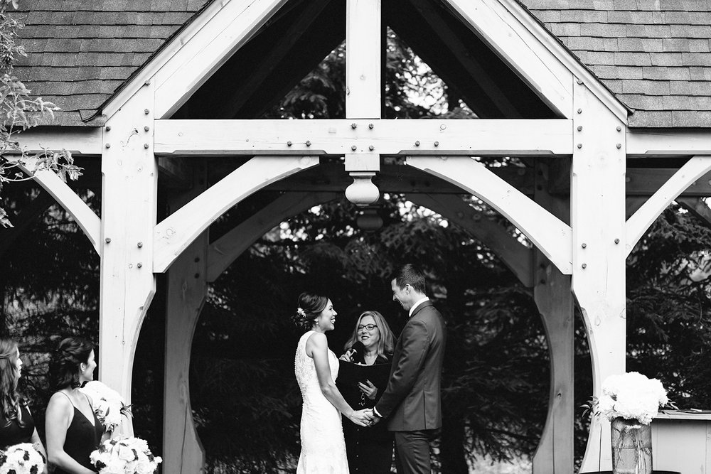 bw-bellamere-winery-ceremony-rustic-bride-and-groom-saying-vows-cinematic-emotional-laughing-toronto's-best-wedding-photographers-candid-documentary-style-photography-london-ontario-winery-wedding-inspiration.jpg