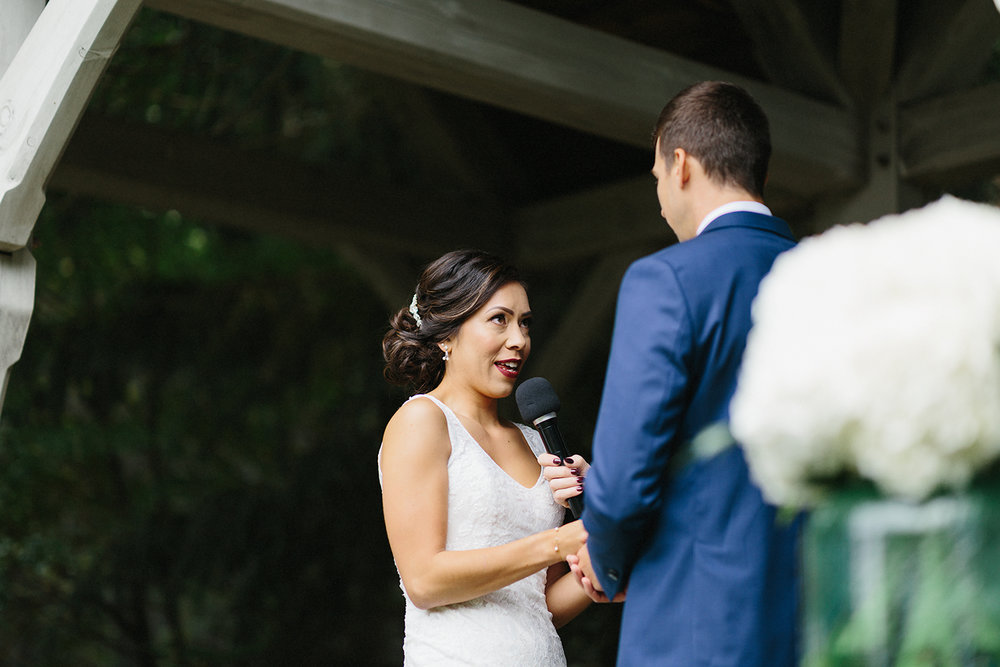 bellamere-winery-ceremony-rustic-bride-saying-vows-cinematic-emotional-laughing-toronto's-best-wedding-photographers-candid-documentary-style-photography-london-ontario-winery-wedding-inspiration.jpg