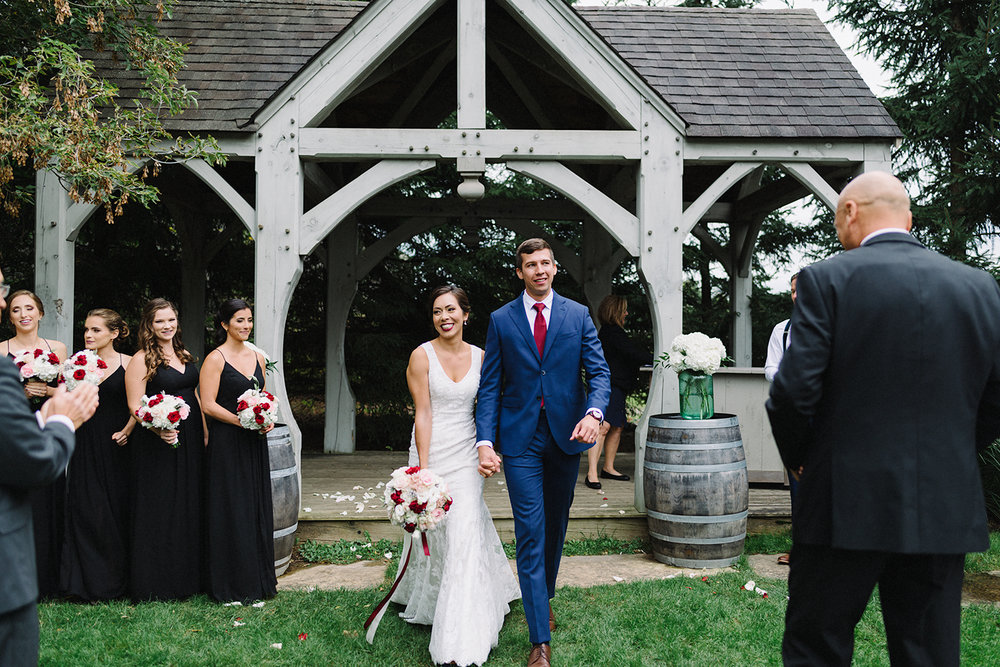 bride-and-groom-recessional-cute-cinematic-toronto's-best-wedding-photographers-candid-documentary-style-photography-london-ontario-winery-wedding-inspiration.jpg