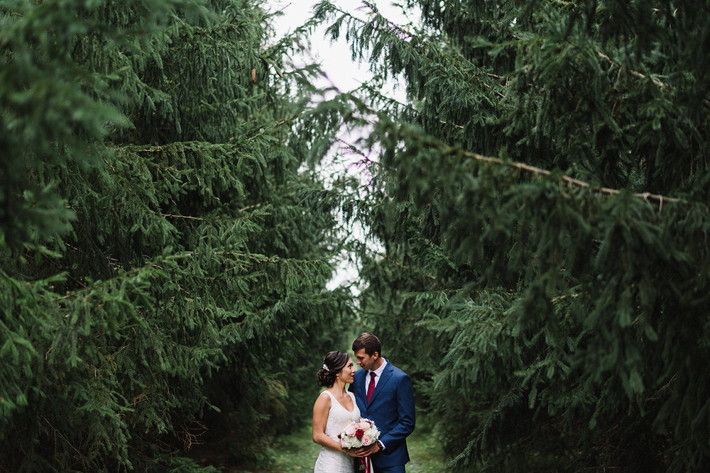 bride-and-groom-couples-portraits-in-forest-wilderness-outdoors-romantic-real-wedding-photos-toronto's-best-wedding-photographers-candid-documentary-style-photography-london-ontario-winery-wedding-inspiration.jpg