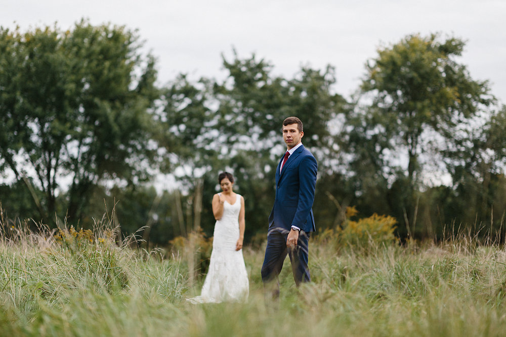 Backyard-family-intimate-cottage-wedding-chatum-kent-toronto-ontario-film-photographer-ryanne-hollies-photography-diy-string-lights-and-lanterns-reception-dinner-documentary-wooden-harvest-tables-diy-decor-bride-and-groom-kiss-speeches.jpg