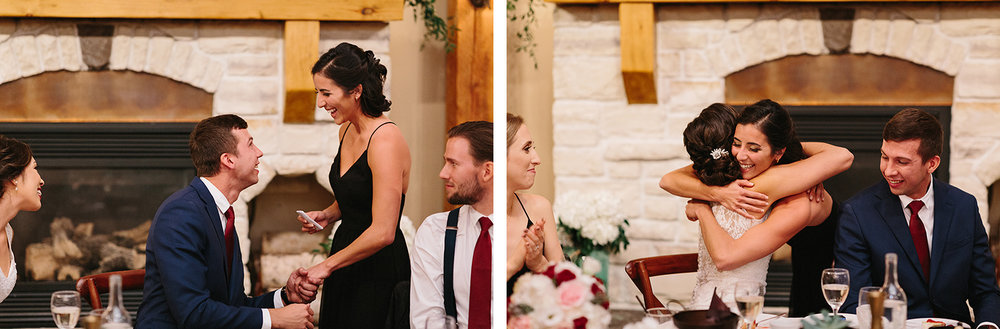 35-reception-diy-bride-and-groom-speeches-by-made-of-honour-hugging-bride-toronto's-best-analog-documentary-wedding-photographers-candid-photography-london-ontario-wedding-inspiration.jpg