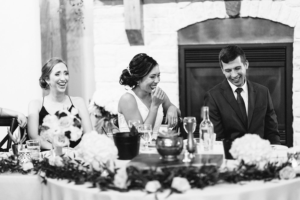 reception-diy-bride-and-groom-speeches-bride-laughing-toronto's-best-analog-documentary-wedding-photographers-candid-photography-london-ontario-wedding-inspiration.jpg