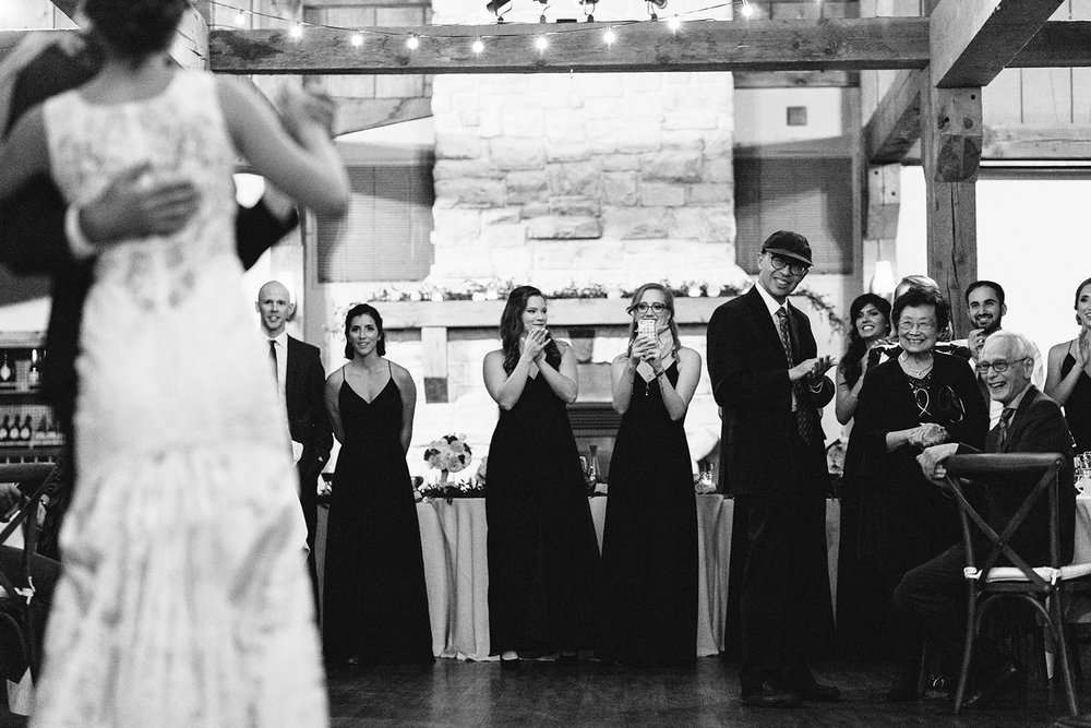bw-artistic-reception-bride-and-groom-first-dance-choreographed-guests-watching-moments-toronto's-best-analog-documentary-wedding-photographers-candid-photography-london-ontario-wedding-inspiration.jpg
