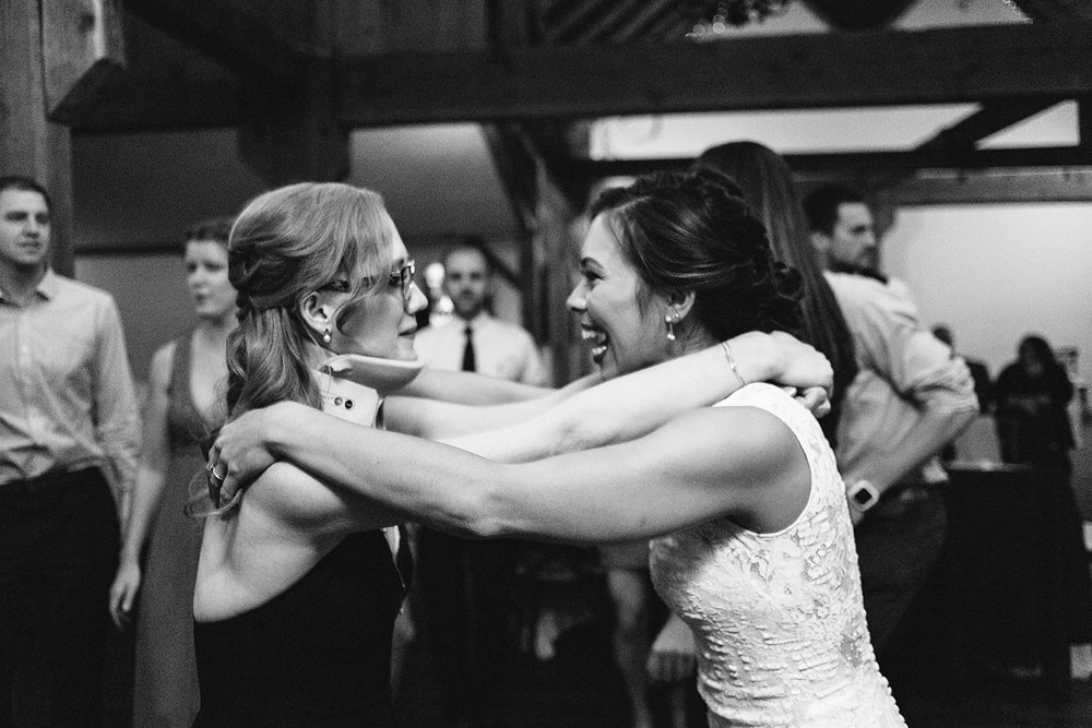 bw-party-guests-dancing-having-fun-partying-candid-moments-toronto's-best-analog-documentary-wedding-photographers-candid-photography-london-ontario-wedding-inspiration.jpg